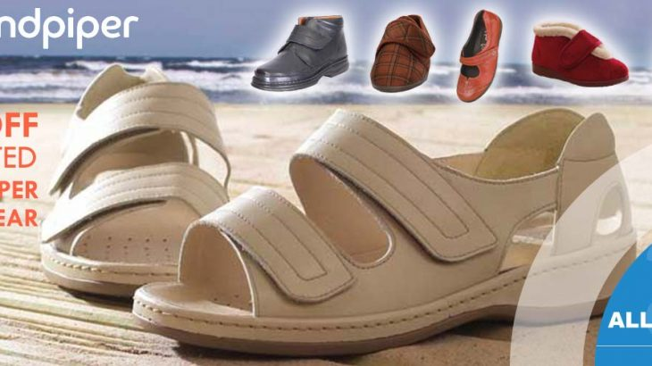 Sandpiper sandals on beach with other footwear