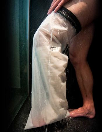 Man having shower with leg inside adult full leg bandage protector.