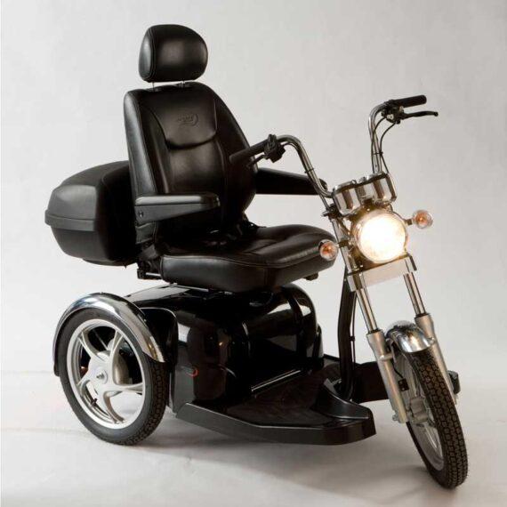 Black mobilty Scooter, headlight on.