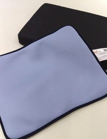 Pale blue seat pad with black cushion.